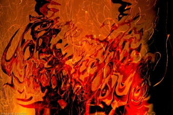 abstract artwork : fluid floating shapes in a fire flame